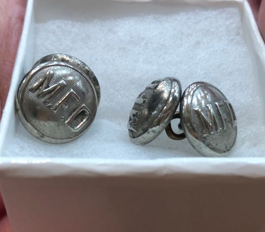 The Milwaukee Fire Department in 1930 awarded these cuff links to Harvey Krause for his bravery as head usher in evacuating 1,000 people from a theater filled with smoke. Krause's daughter, Linda Gelles, surprised her son Sean Gelles with the cuff links at his graduation from the Milwaukee Fire Academy.