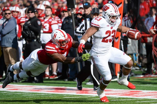Wisconsin's Jonathan Taylor escapes the tackle of Nebraska linebacker Mohamed Barry. Taylor rushed for 204 yards and a pair of touchdowns and set a new record for rushing yards through a junior season.