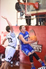 Cotter's Jackson Evans goes up for two against Jasper on Saturday at Flippin.