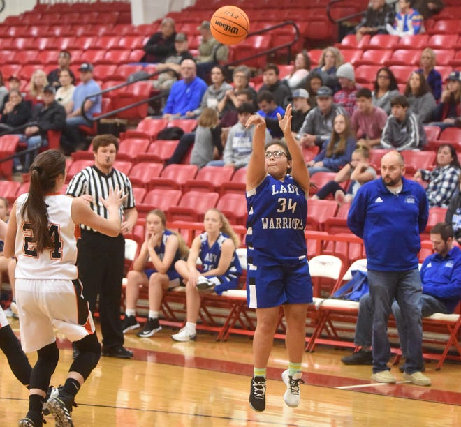 Cotter's Ashley Garay launches a 3-pointer against Calico Rock on Saturday at Flippin.