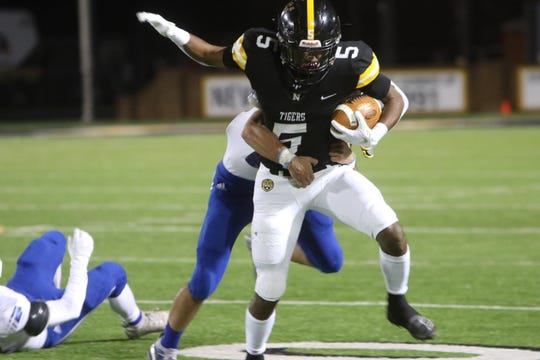 Running back Max Hunter (5) carried 15 times for 126 yards and two touchdowns in Neville's 33-14 win at DeRidder in Friday night's second round of the Class 4A playoffs.