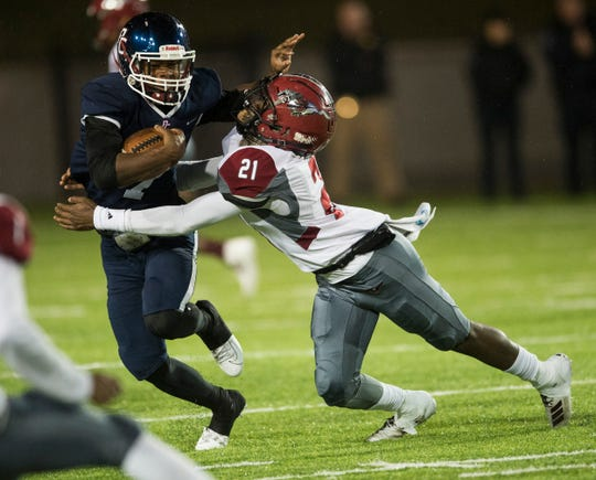 Park Crossing's Trevor Robinson (7) is taken down by Stanhope Elmore's Quentarius Edwards (21) at Cramton Bowl in Montgomery, Ala., on on Friday, Nov. 15, 2019. Park Crossing leads Stanhope Elmore 21-19 at halftime.