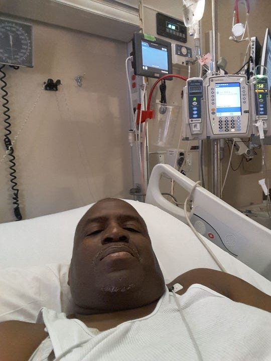 Michael Jefferson II lays in his hospital bed prior to treatment.