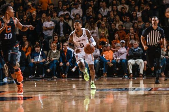 Auburn guard J'Von McCormick dribbles up the court against CSUN on Friday, Nov. 15, 2019.