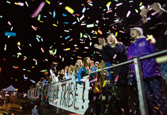 Wetumpka students celebrate a touchdown with confetti canons.