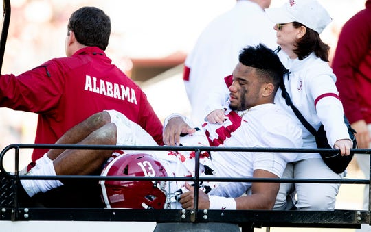 Alabama quarterback Tua Tagovailoa (13) is taken from the field after being injured Against Mississippi State at Davis Wade Stadium on the MSU campus in Starkville, Ms., on Saturday November 16, 2019.
