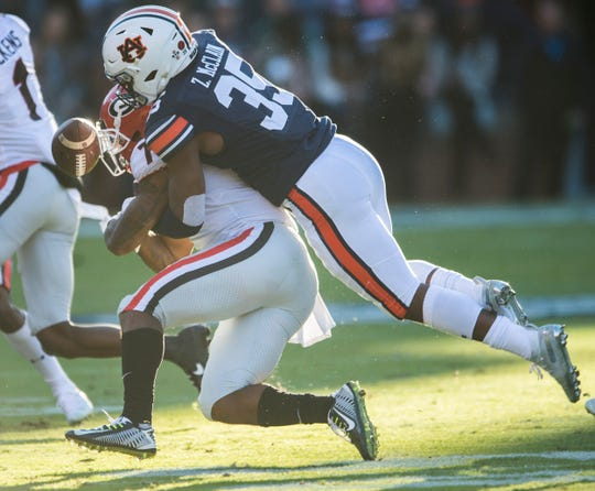 Georgia running back D'Andre Swift (7) fumbles the ball as he is tackled by Auburn linebacker Zakoby McClain (35) at Jordan-Hare Stadium in Auburn, Ala., on Saturday, Nov. 16, 2019.