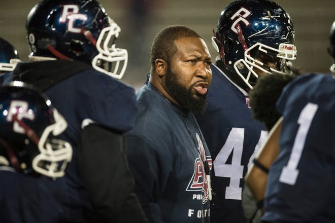 Park Crossing head coach Clayton Harris talks with his team during a timeout at Cramton Bowl in Montgomery, Ala., on on Friday, Nov. 15, 2019. Park Crossing leads Stanhope Elmore 21-19 at halftime.