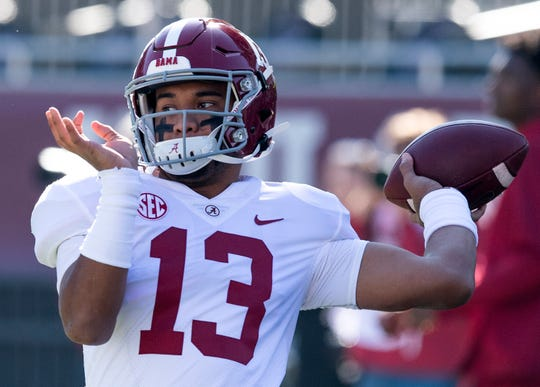 Alabama quarterback Tua Tagovailoa (13) warms up before the Alabama vs. Mississippi State game at Davis Wade Stadium on the MSU campus in Starkville, Ms., on Saturday November 16, 2019.