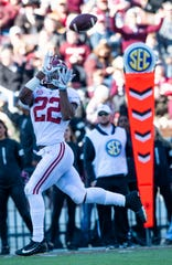 Alabama running back Najee Harris (22) catches a touchdown pass against Mississippi State at Davis Wade Stadium on the MSU campus in Starkville, Ms., on Saturday November 16, 2019.