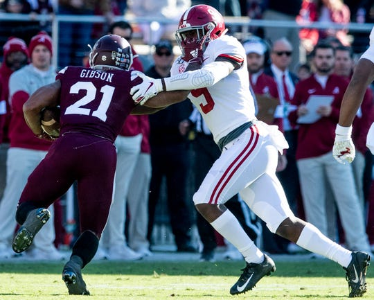 Alabama defensive back Jordan Battle (9) stops Mississippi State running back Nick Gibson (21) at Davis Wade Stadium on the MSU campus in Starkville, Ms., on Saturday November 16, 2019.