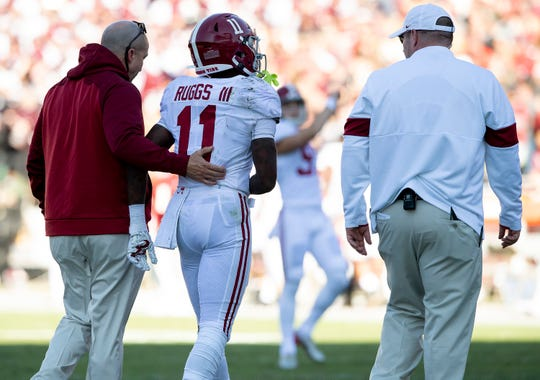 Alabama wide receiver Henry Ruggs, III, (11) is helped off of the field after being injured against Mississippi State at Davis Wade Stadium on the MSU campus in Starkville, Ms., on Saturday November 16, 2019.