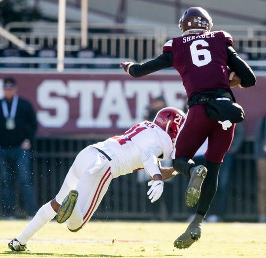 Alabama defensive back Jared Mayden (21) stops Mississippi State quarterback Garrett Shrader (6) at Davis Wade Stadium on the MSU campus in Starkville, Ms., on Saturday November 16, 2019.