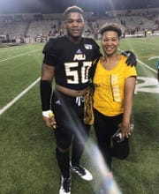 Darius King stands with his mother Katrice Williams post-game.