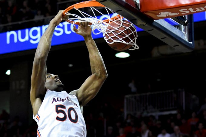 Auburn center Austin Wiley (50) dunks against Cal State Northridge during the first half of an NCAA college basketball game Friday, Nov. 15, 2019, in Auburn, Ala. (AP Photo/Julie Bennett)