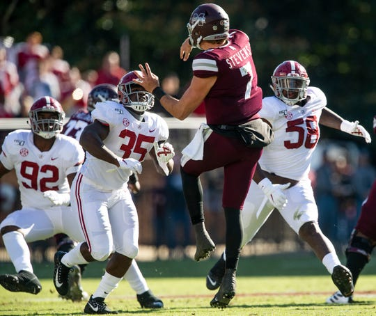 Mississippi State quarterback Tommy Stevens (7) is pressured by Alabama linebacker Shane Lee (35) and defensive lineman Christian Barmore (58) at Davis Wade Stadium on the MSU campus in Starkville, Ms., on Saturday November 16, 2019.