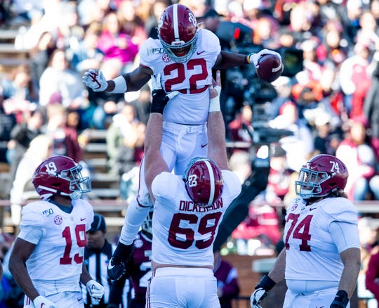 Alabama running back Najee Harris (22) is lifted by offensive lineman Landon Dickerson (69) after scoring against Mississippi State at Davis Wade Stadium on the MSU campus in Starkville, Ms., on Saturday November 16, 2019.