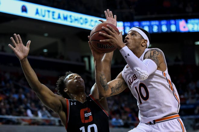 Auburn guard Samir Doughty (10) drives to the basket past CSUN guard Darius Brown II (10) on Friday, Nov. 15, 2019, in Auburn, Ala.