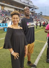 "Katrice Williams and Micheal Jefferson Sr. stand on the sideline together, before ""Beat out Breast Cancer"" game with Alcorn State, Oct. 5."