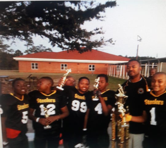 Michael Jefferson II wins a little league championship with the Cottage Hill Steelers when he was 11.