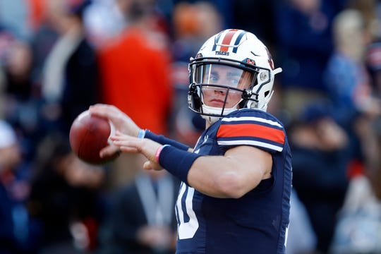 Auburn quarterback Bo Nix (10) warms up before an NCAA college football game against Georgia, Saturday, Nov. 16, 2019, in Auburn, Ala.