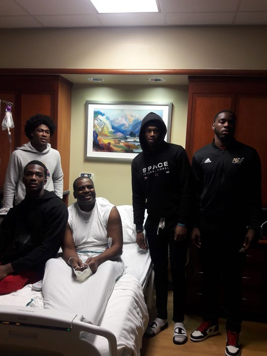 Michael Jefferson II and his teammates visit Micheal Jefferson Sr.at the hospital