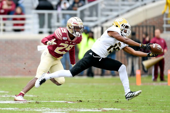 Nov 16, 2019; Tallahassee, FL, USA; Alabama State Hornets wide receiver Jahod Booker (15) battles Florida State Seminoles defensive back Isaiah Bolden (29) for a pass during the first half at Doak Campbell Stadium. Mandatory Credit: Melina Myers-USA TODAY Sports