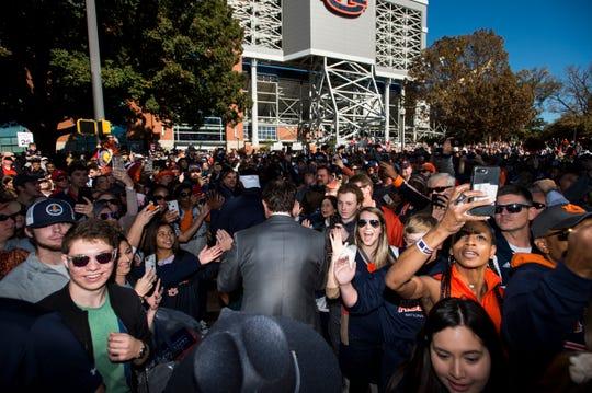 Auburn head coach Gus Malzahn greets fans during Tiger Walk at Jordan-Hare Stadium in Auburn, Ala., on Saturday, Nov. 16, 2019.