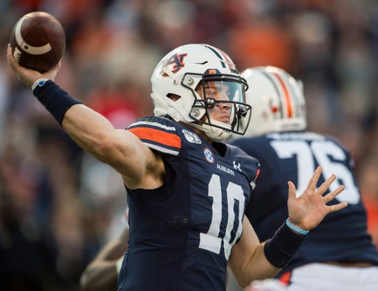 Auburn quarterback Bo Nix (10) throws the ball at Jordan-Hare Stadium in Auburn, Ala., on Saturday, Nov. 16, 2019.
