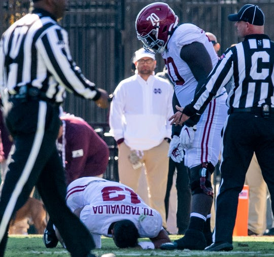 Alabama quarterback Tua Tagovailoa (13) is injured on the turn against Mississippi State at Davis Wade Stadium on the MSU campus in Starkville, Ms., on Saturday November 16, 2019.