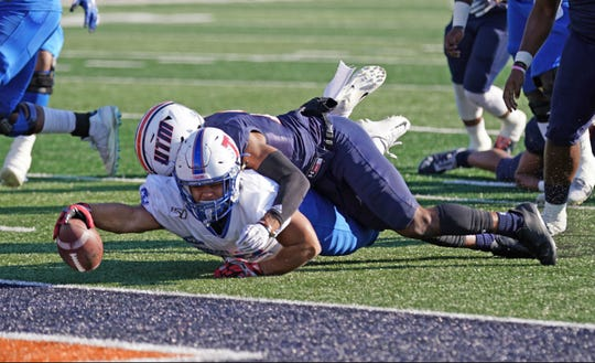 Tennessee State's Seth Rowland tries to get the ball across the goal line against host UT Martin Saturday.