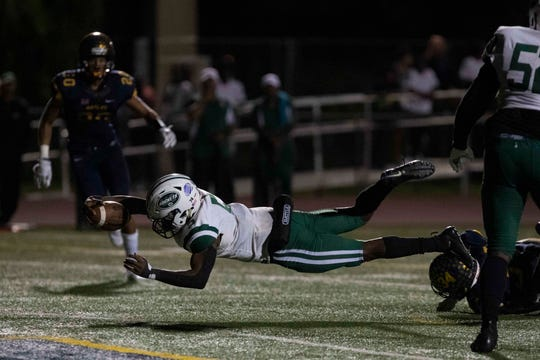 Miami Central's Kejon Owens scores a touchdown against Naples during the 6A regional semifinal game, Friday, Nov. 15, 2019, at Staver Field in Naples.