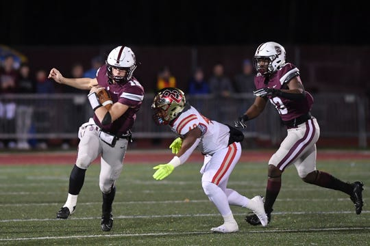 Bergen Catholic at Don Bosco Prep in the Non-Public 4 football quarterfinal playoff on Friday, November 15, 2019. DB #12 QB Jake Robbins avoids a tackle in the first quarter.
