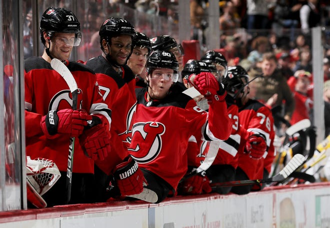 Pavel Zacha #37,Wayne Simmonds #17 and Jesper Boqvist #90 of the New Jersey Devils celebrate teammate Blake Coleman's goal in the final minute of the second period against the Pittsburgh Penguins at Prudential Center on Nov. 15, 2019 in Newark, N.J.
