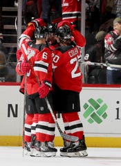 Travis Zajac #19 of the New Jersey Devils celebrates his goal with teammates Andy Greene #6 and Blake Coleman #20 in the first period against the Pittsburgh Penguins at Prudential Center on Nov. 15, 2019 in Newark, N.J.