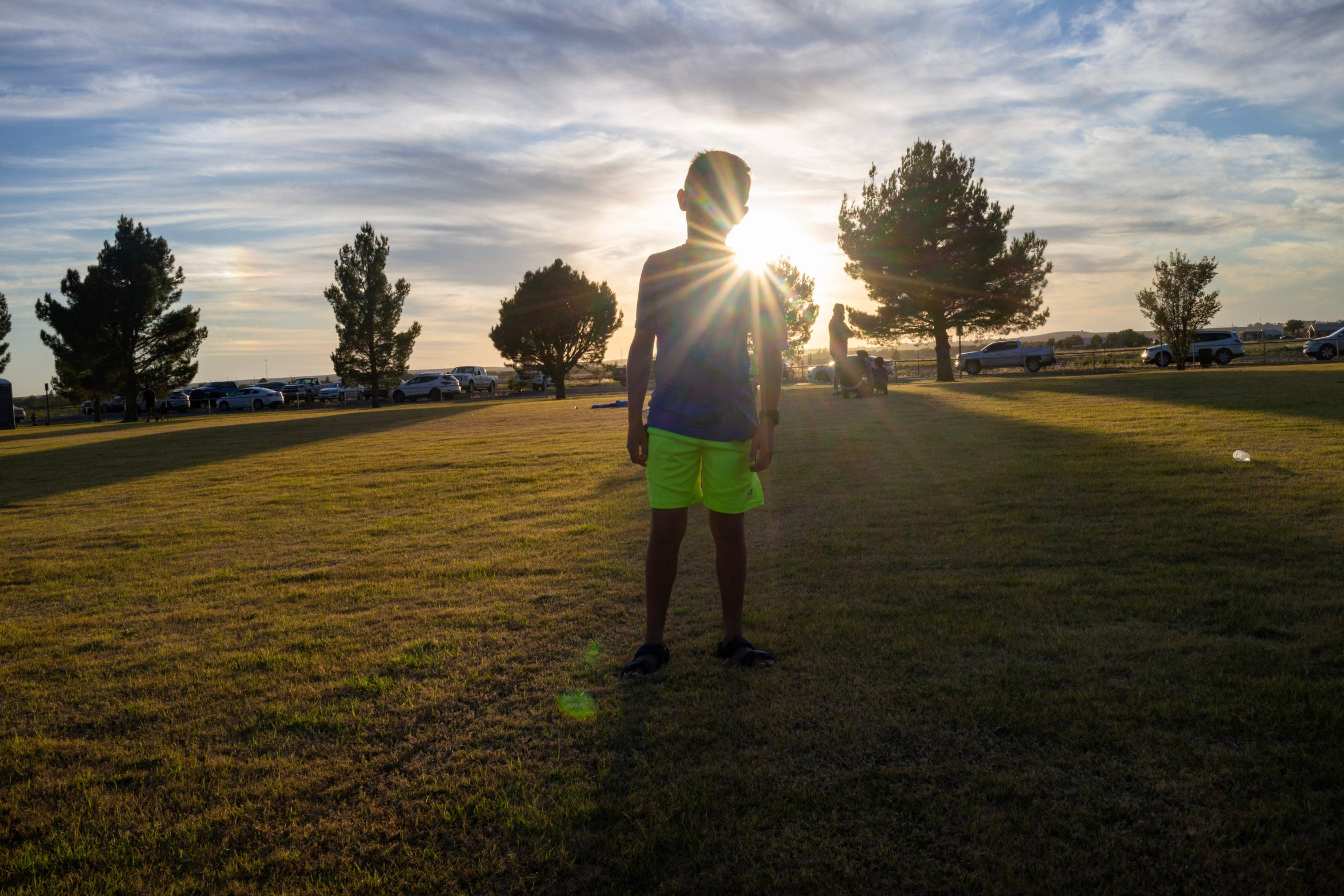 Stephanie Baker's son Jacob waits for his brothers to finish their practice at the soccer fields in Roswell. He and his brothers lived with their grandmother, Connie, while Stephanie was incarcerated.
