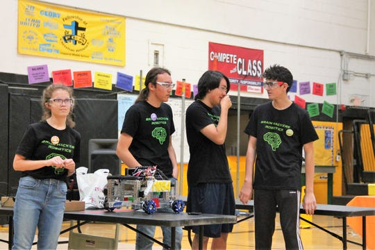 The Brain Hackers Team prepares to go into the competition space at Chaparral Middle School's First Tech Challenge Qualifying Tournament.