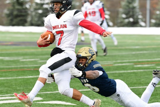 Country Day linebacker Taj Abdur-Rahman attempts to bring down Milan quarterback Tristen Hines. Detroit Country Day defeats Milan, 24-6, in the regional final.