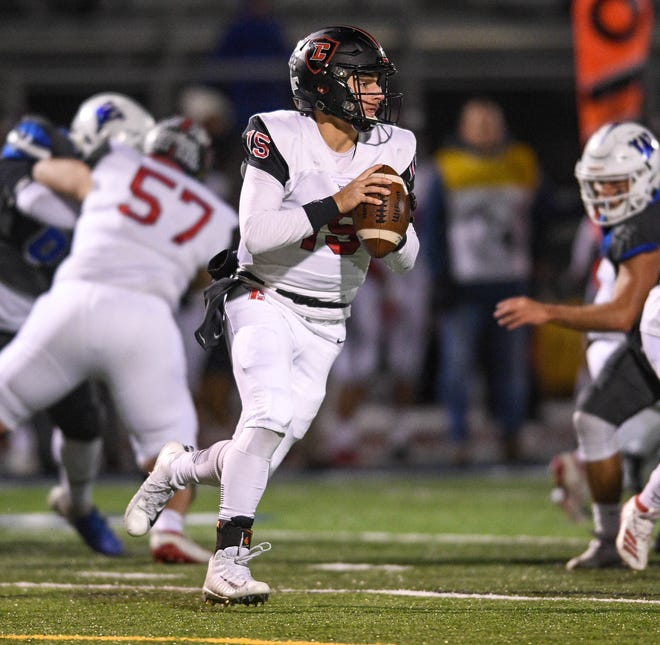 Livonia Churchill quarterback Gavin Brooks drops back for a pass against Walled Lake Western in the regional final on Nov. 15, 2019.
