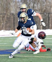 Country Day running back Anthony Ammori cuts. Detroit Country Day defeats Milan, 24-6, in the regional final.