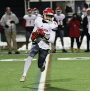Port Huron's Nijere Finney tries to find running room.