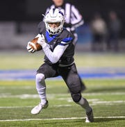 Walled Lake Western's Cam Kinaia sprints towards the end zone against Livonia Churchill in the regional final on Nov. 15, 2019.