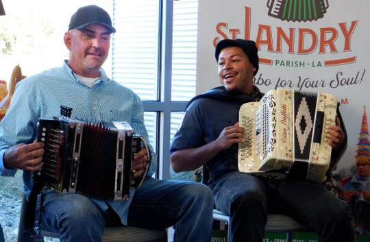 Horace Trahan sits down with accordionist Ryan Perkins (right) as the two perform a French music house song during the monthly Zydeco Capital jam session at the St. Landry Parish Visitors Center. Perkins and several other younger accordionists joined Trahan and his father-in-law Rodney Bertrand for the two-hour performance.