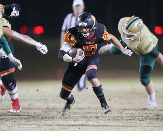 Palm Desert's Simon Gaete breaks through the Santa Barbara defense in a CIF--SS playoff game. Santa Barbara won 42-32.