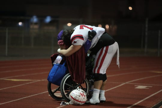 Palm Springs' senior lineman Julian Polendo hugs his grandfather, Manuel Dagnino, after their CIF-SS Division 9 football game loss against North High in Torrence, Calif., on Friday, November 15, 2019.