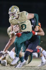 Santa Barbara quarterback Deacon Hill tries to shake off a Palm Desert tackler on Friday. Hill threw for 362 yards and four touchdowns and rushed for another on the ground.