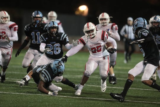 Palm Springs' Arieon Capler breaks a tackle during the CIF-SS Division 9 quarterfinal football game against North High in Torrence, Calif., on Friday, November 15, 2019.
