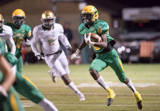 Demarius McGhee (6) carries the ball during the Trinity vs Pensacola Catholic playoff football game at Pensacola Catholic High School in Pensacola on Friday, Nov. 15, 2019.