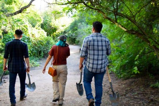 Volunteers walk into Parque La Colorada on Oct. 4, 2019, to plant agave.