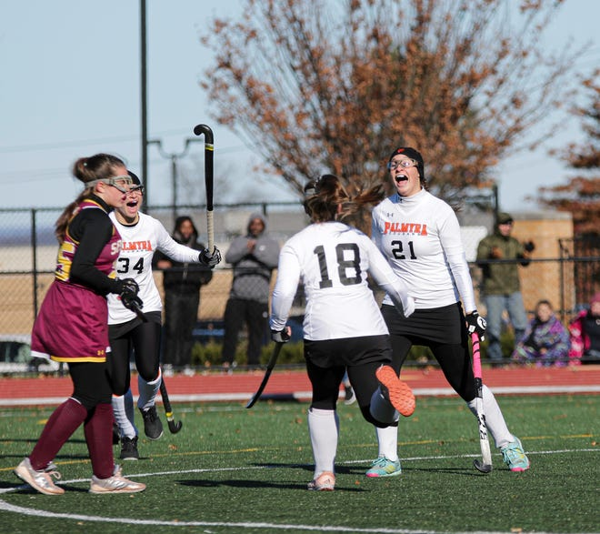 Palmyra's Lauren Wadas (21) celebrates her goal with teammates Alexa Derr (18) and Skylar Dise (34) during the state finals. Wadas was named a high school All-American on Wednesday.